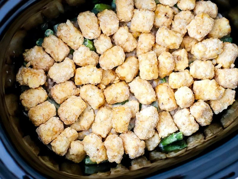 Crock pot tater tot casserole ready to cook.
