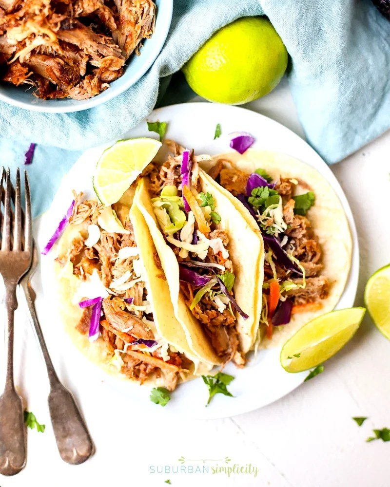 These Easy Crock Pot Pulled Pork Tacos are tender and full of slow-cooked flavor.  Plus, this simple, budget-friendly recipe is great for multiple meals.