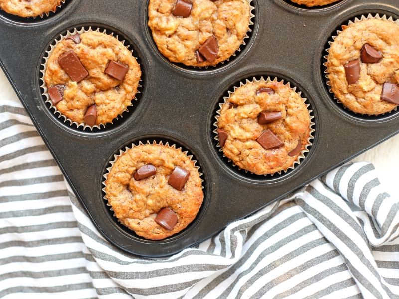 Pan full of banana almond butter muffins.