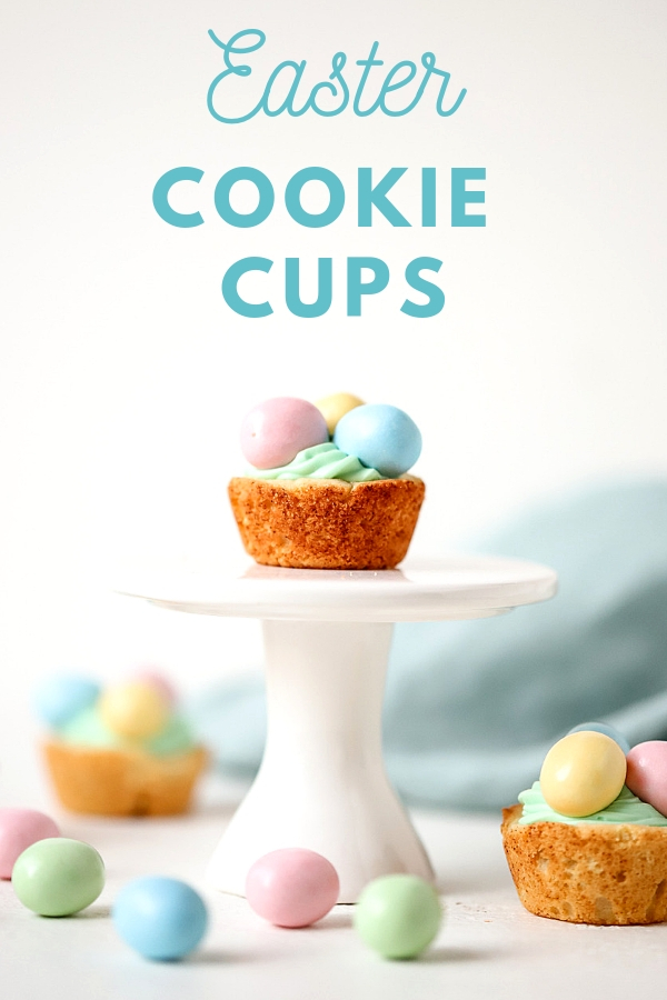 Enjoy a mini sweet bite this Easter! The combination of sugar cookies filled with creamy frosting and candy make these Easter Cookie Cups an eggcellent treat! #suburbansimplicity #cookiecups #eastertreats #easterdesserts