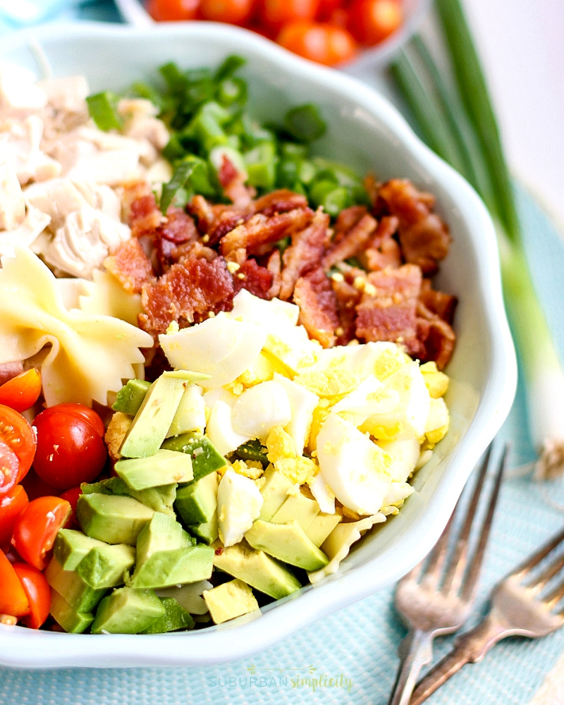 Ingredients for Cobb Pasta Salad in a bowl before they're tossed.