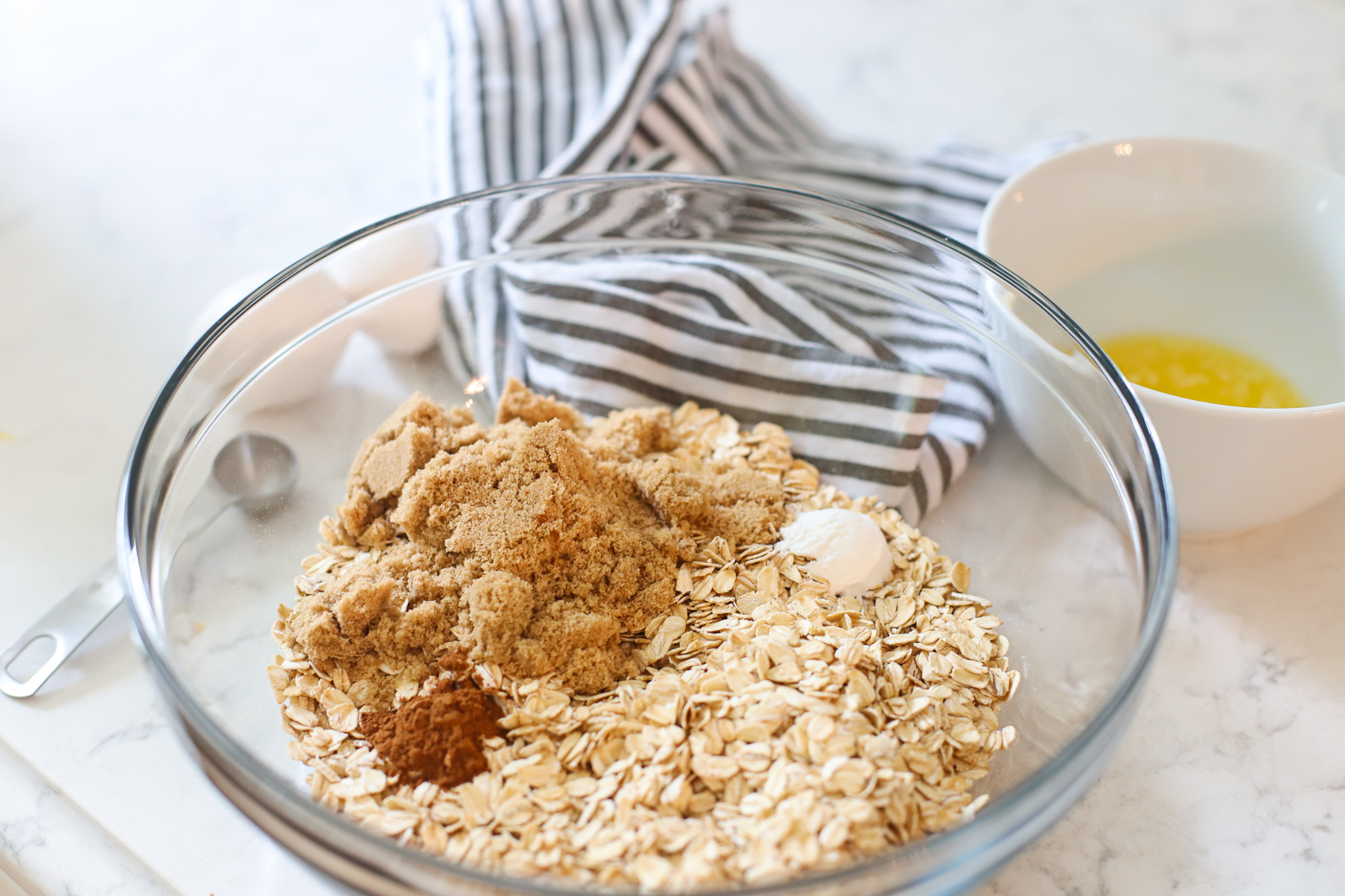 Oatmeal, brown sugar and cinnamon in a bowl.