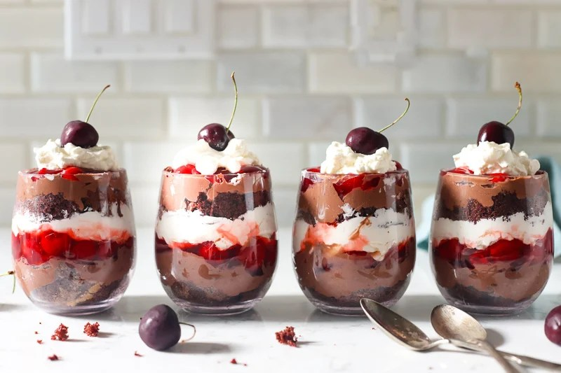 4 chocolate cherry trifles on the counter