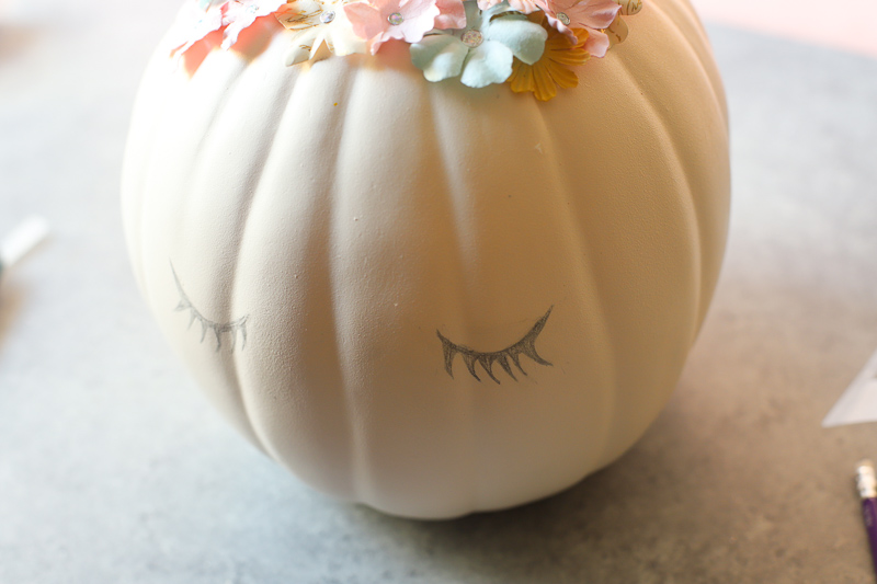 pencil drawn eyelashes on pumpkin
