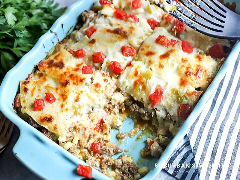 Baked Beef enchiladas in a casserole dish.
