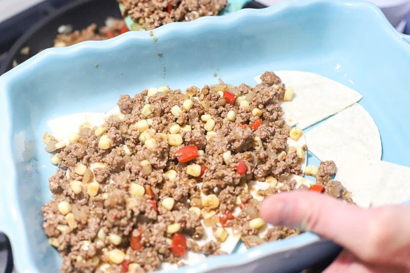 Assembling a beef enchilada casserole