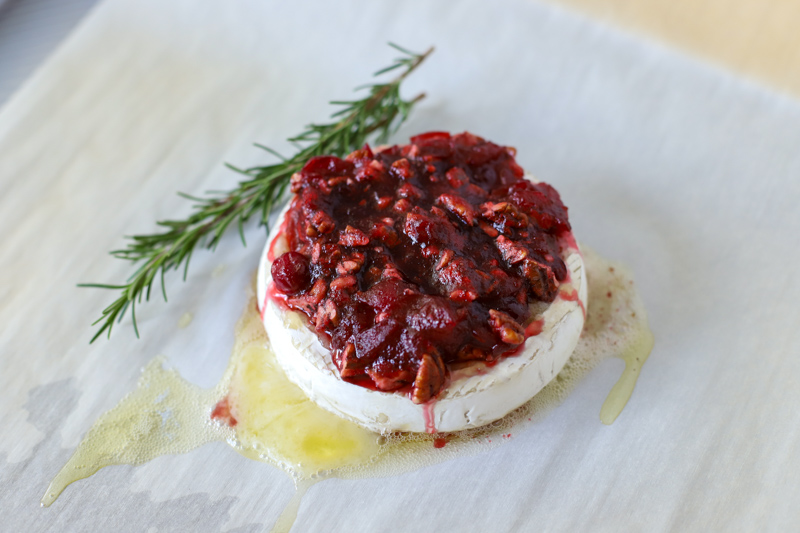 Baked Cranberry Brie is an easy and impressive 15-minute appetizer for the holidays that everyone loves. With a few simple ingredients and minutes of prep time, you have one of the best tasting Christmas recipes!