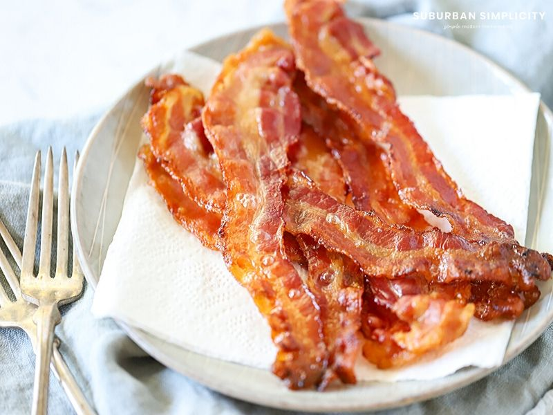 Cooked bacon on a plate.