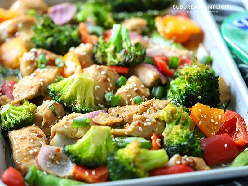 Sheet pan full of Sesame Chicken and vegetables
