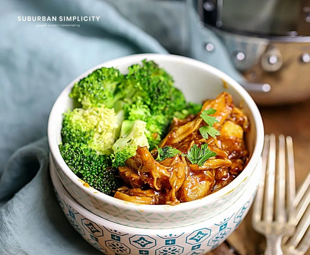 A bowl of food with broccoli, with Chicken made in the Slow cooker