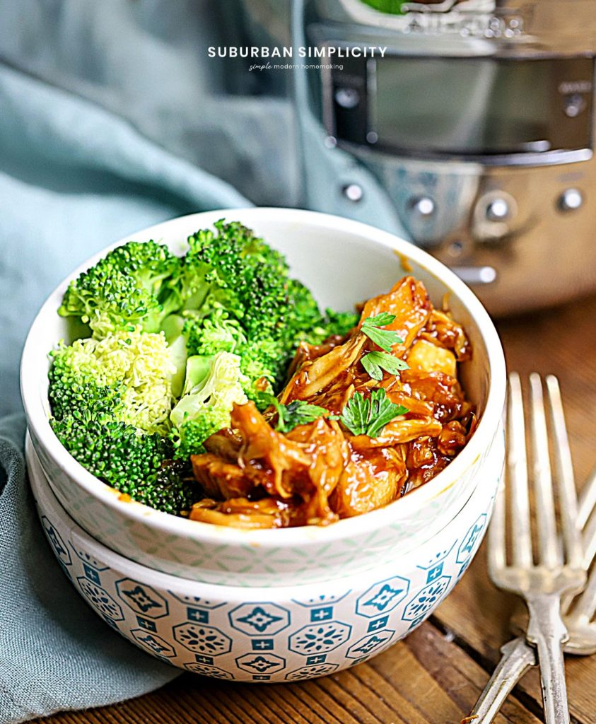 Slow Cooker Honey Garlic Chicken in a bowl with Broccoli