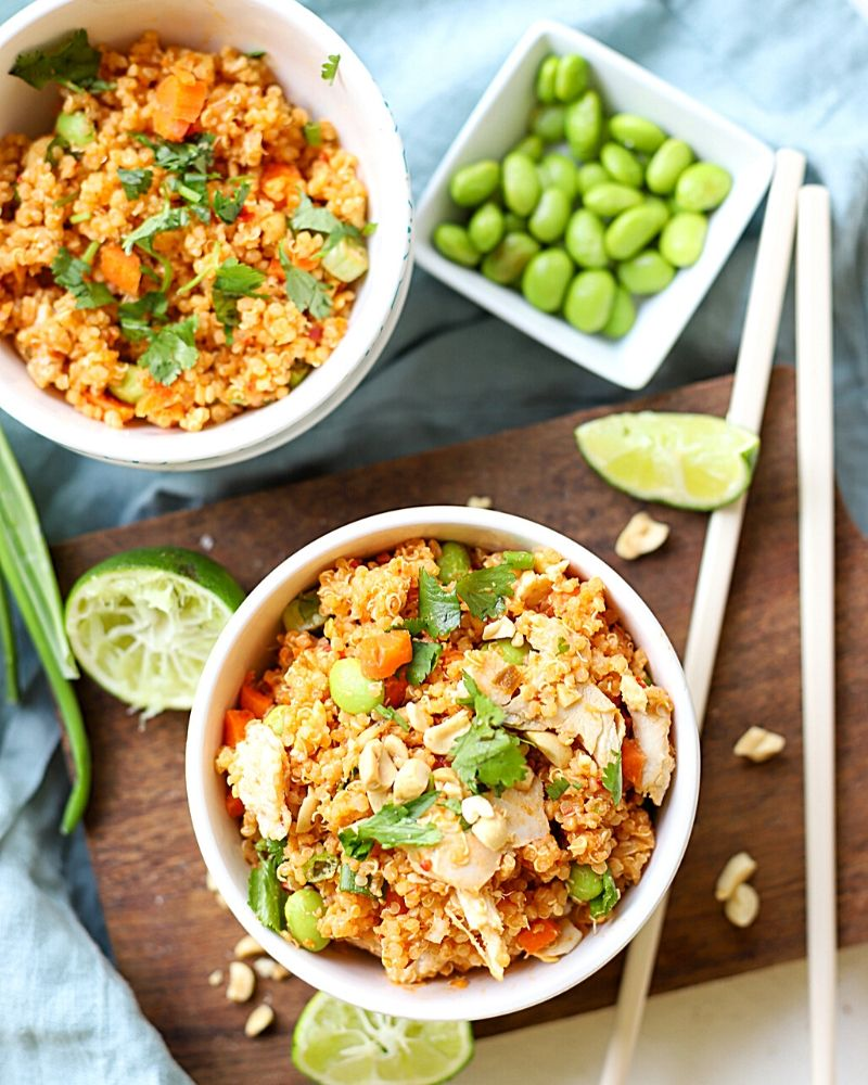 Bowls filled with Thai Flavored quinoa and chicken