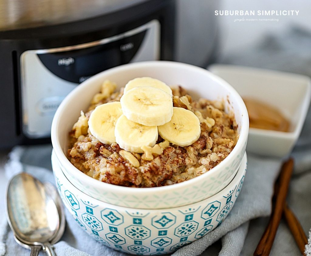 crockpot peanut butter oatmeal in a bowl with bananas