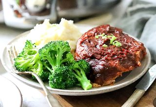Slow Cooker BBQ Pork Chops on a plate with broccoli