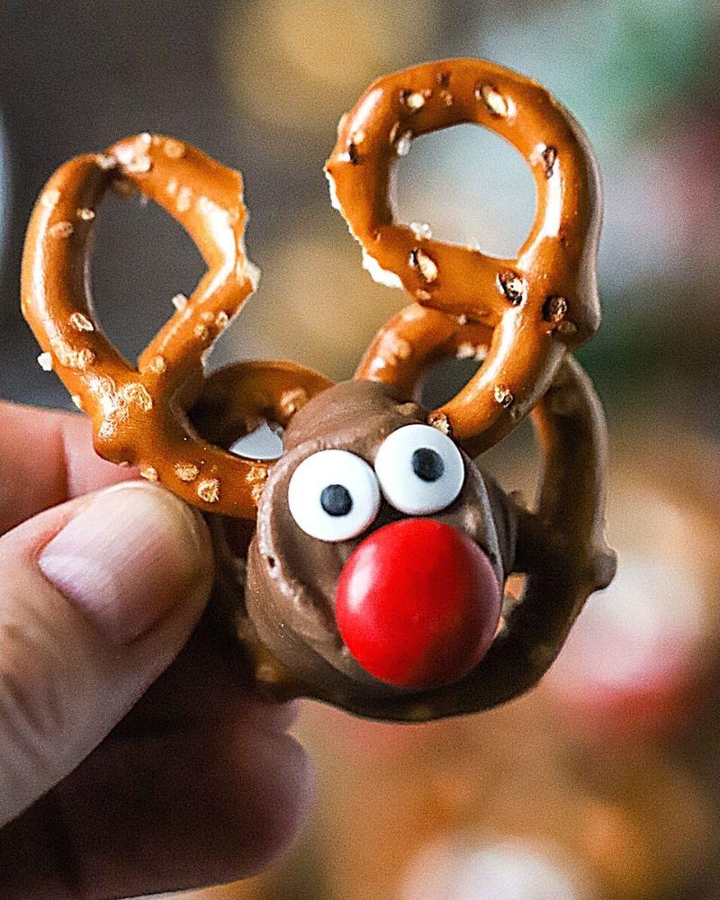 a hand holding a Reindeer Pretzel
