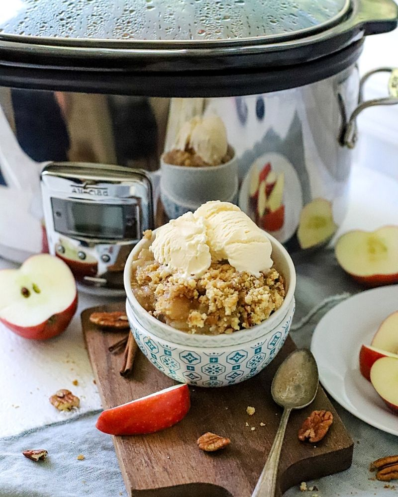 Apple dump cake in front of crockpot