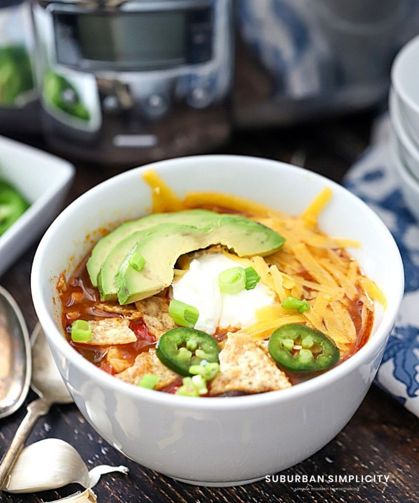 slow cooker chicken enchilada soup in a bowl