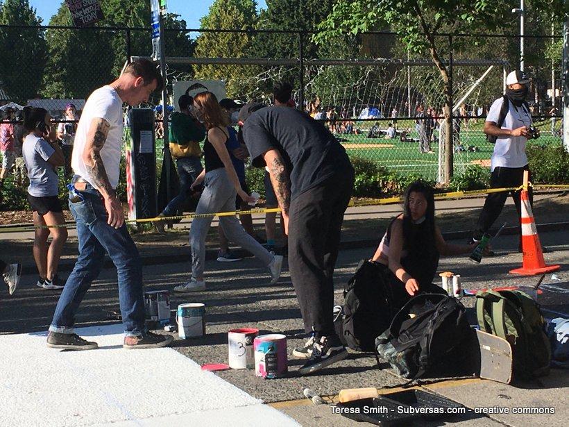 artists painting BLM Mural, Capitol Hill autonomous zone