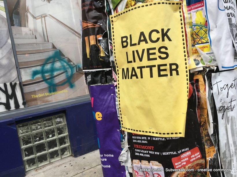 Black Lives Matter sign and anarchy symbol