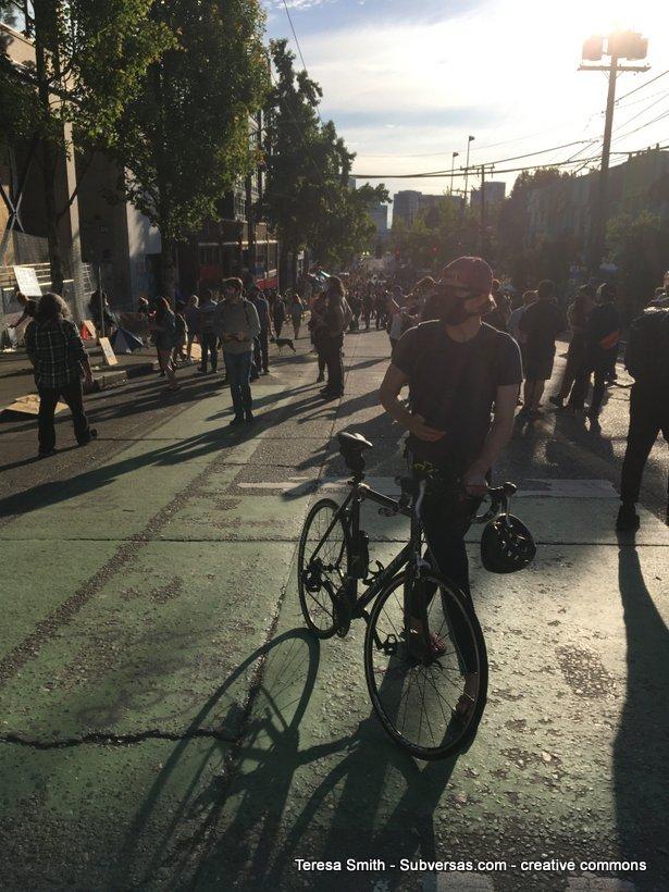 bicyclist at Capitol Hill autonomous zone