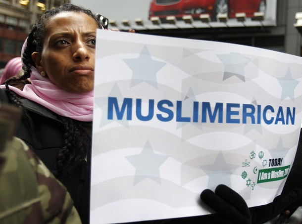 "A woman holds a sign at the ""Today, I Am A Muslim, Too"" rally in New York City March 6, 2011. The rally was held in response to the upcoming Congressional hearings led by Peter King (R-LI) to protest the targeting of American Muslims and Arabs. REUTERS/Jessica Rinaldi (UNITED STATES - Tags: SOCIETY POLITICS)"