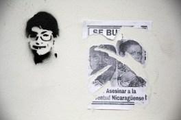 Estencil de Alvaro Conrado, asesinado el 20 de Abril, junto a él un d