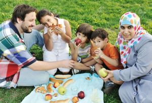 http://previews.123rf.com/images/zurijeta/zurijeta1010/zurijeta101000190/8120400-Muslim-family-mother-and-father-with-three-children-together-in-nature-sitting-and-eating-on-green-g-Stock-Photo.jpg