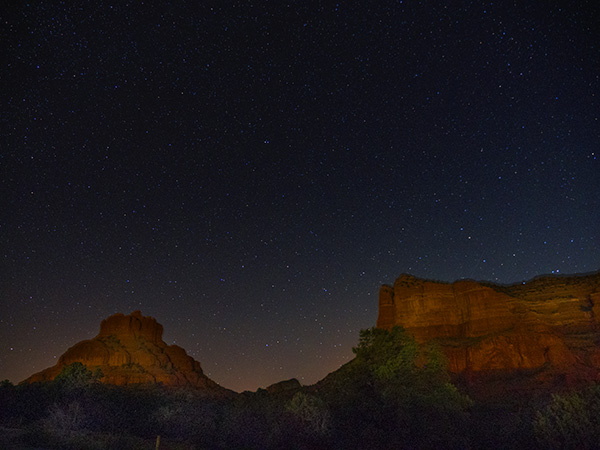 night sky over courthouse butte and bell rock photo
