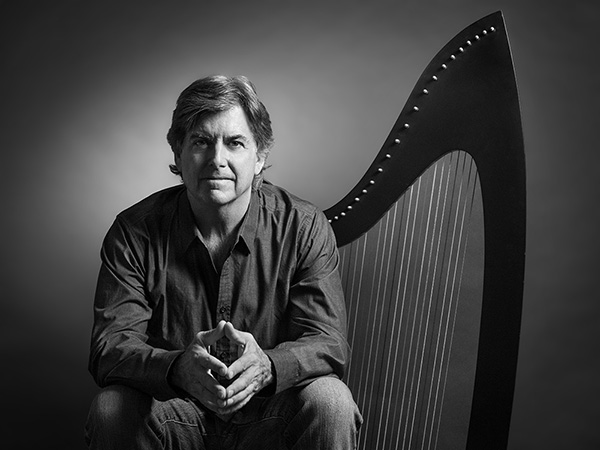 photo of peter sterling harp music performer black and white