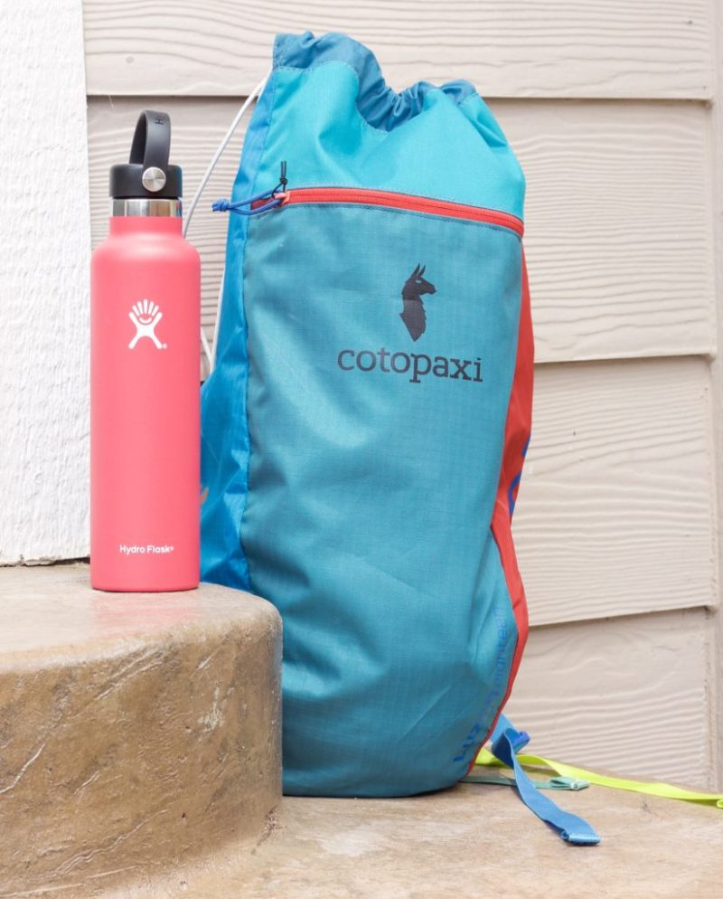 Blue Cotopaxi backpack with pin Hydro Flask.