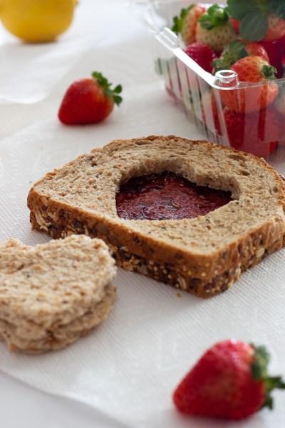 Heart shaped toast with strawberry jam. Easy Valentine's Day breakfast idea.