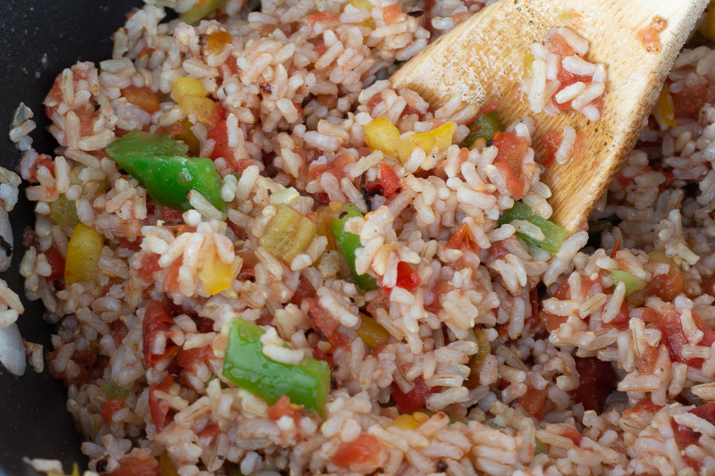 Brown rice with roasted tomatoes and chopped bell peppers.