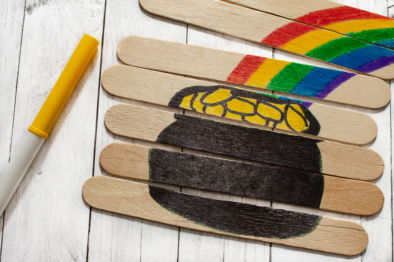 Colored in picture of pot of gold popsicle stick craft