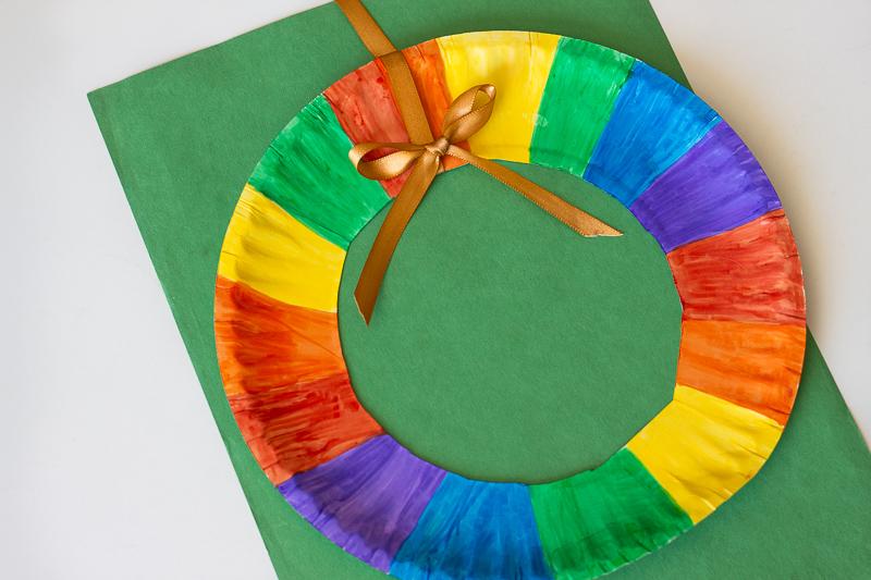 Rainbow Wreath on green construction paper.