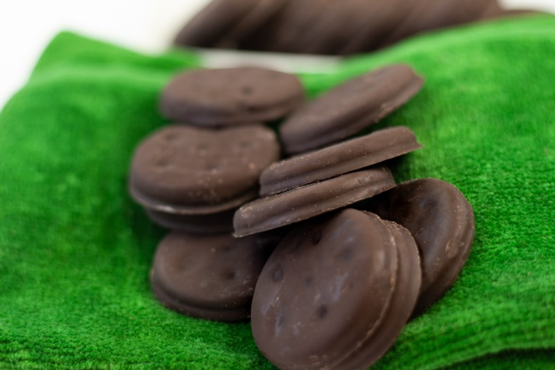 Homemade Thin Mints on a green towel.