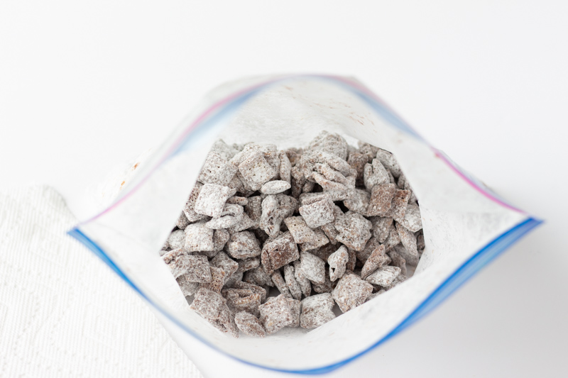 Rice Chex in a plastic bag with powdered sugar.