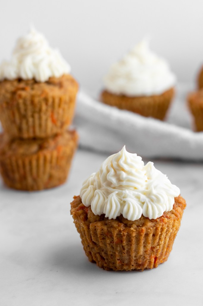 Carrot Cake Cupcakes with white frosting.