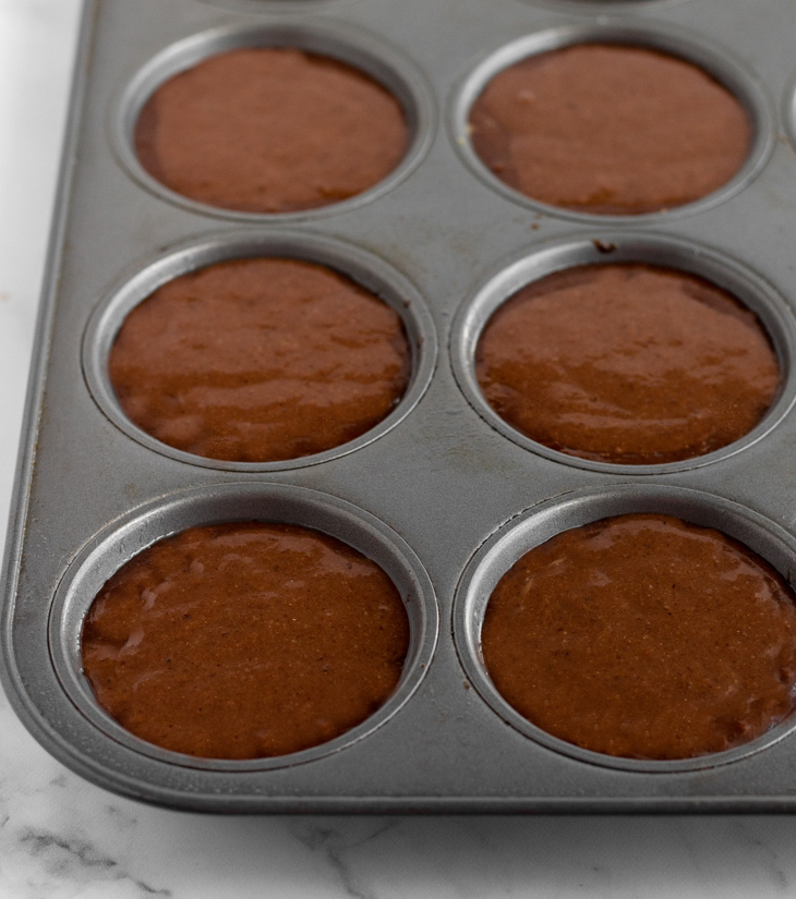 Double chocolate muffin batter in pan.