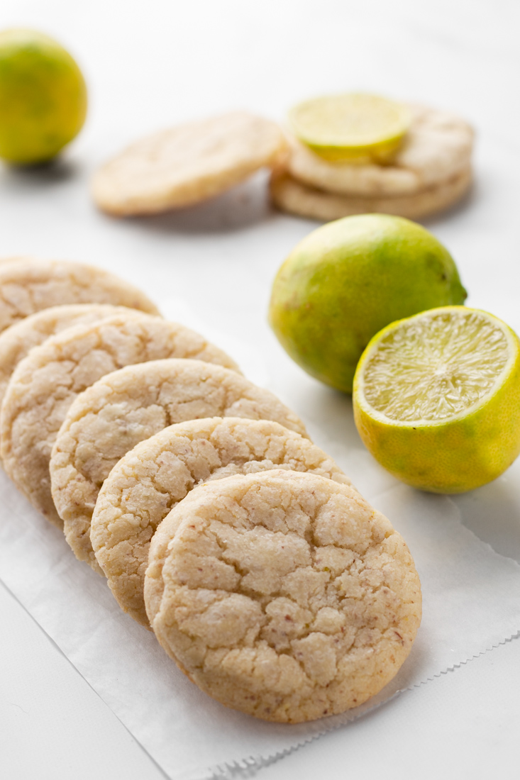 Sugar cookies with limes around.