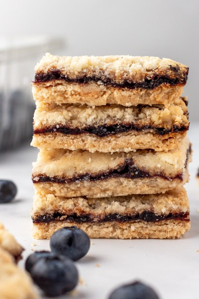 Blueberry crumb bars stacked.