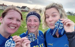 Sian Guyton, Clare Gillibrand and Sally Sandford after finishing the Great Bentley Half Marathon