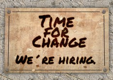 "a sign reading ""time for change. we're hiring"""