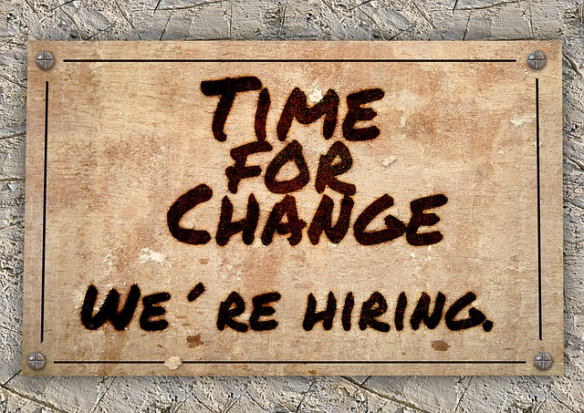 """a sign reading """"time for change. we're hiring"""""""