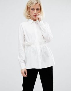 ASOS - http://www.asos.com/lost-ink/lost-ink-textured-shirt-with-ruffle-waist/prd/7209703?CTARef=Saved%20Items%20Image
