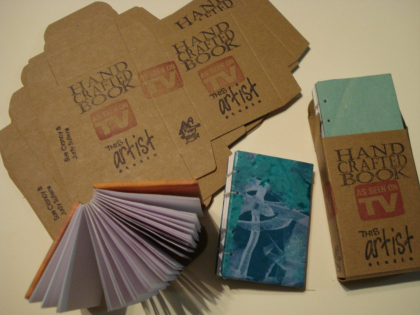 "hand sewn books with handmade paper covers being put into a box for ""vending"" via ArtoMat."