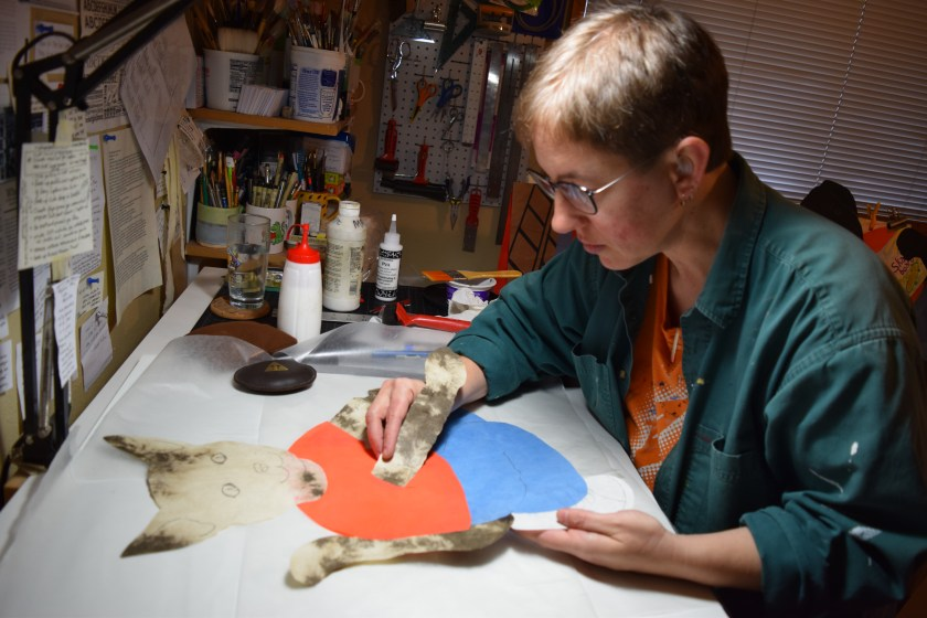 creating a cat character out of cut handmade paper for a public art project