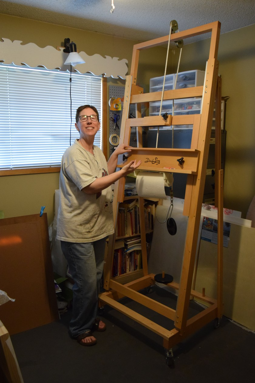 Sue Clancy posing with her new Sorg easel a'la a magazine model