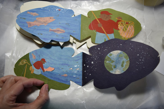 "Two page spreads from an in-progress pop-up book ""A Fish Story"" by Sue Clancy"