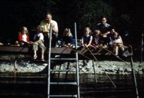 Grandpa Cliff Conard, Dad (Uncle Tom Conard) and assorted cousins on the dock fishing with the bamboo fishing poles.