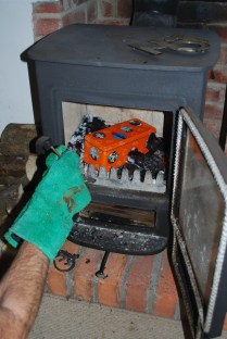making charcoal- placing tin in log-burner